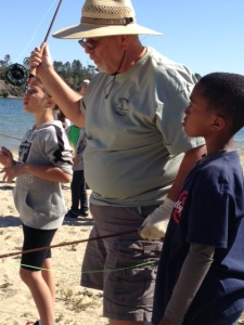 Tracy Fly Fisher teaches casting to students at Shadow Cliffs Reservoir